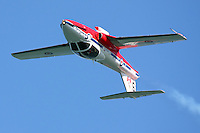 A lone Canadian Snowbird makes an inverted pass in a CT-114 Tutor jet at the start of the teams aerial demonstration during 2008 San Francisco Fleet Week activities.  The Snowbirds are part of the 431 Air Demonstration Squadron and are based out of Moose Jaw, Saskatchewan.The team has flown the Canadian built CT-114 Tutor jet since 1971.