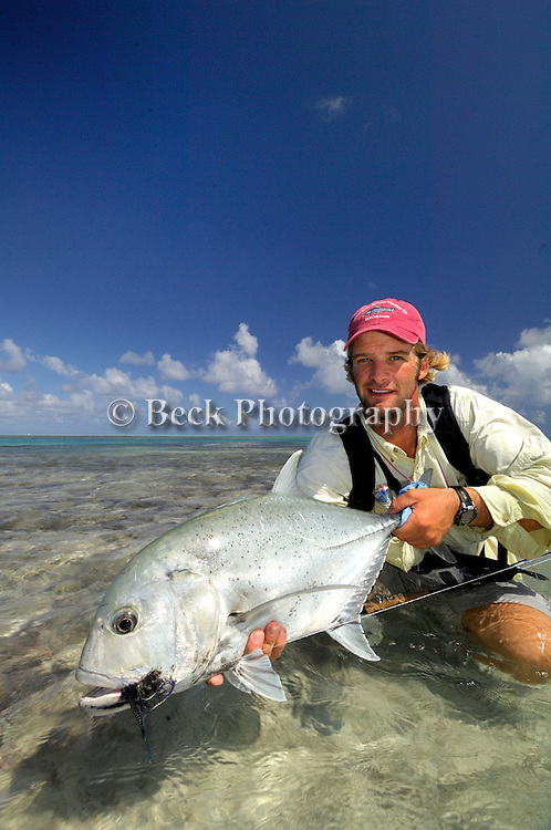 CHAS MARSH WITH A GIANT TREVALLY