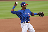 Iowa Cubs second baseman Arismendy Alcantara (3) throws to first during a Pacific Coast League game against the Colorado Springs Sky Sox on May 10th, 2015 at Principal Park in Des Moines, Iowa.  Iowa defeated Colorado Springs 14-2.  (Brad Krause/Four Seam Images)