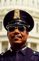 Portrait of a black police man in front of The Capitol in Washington DC, USA