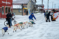 Gunnar Johnson gets help coming off of Front Street and into the finish chute in Nome  during the 2017 Iditarod on Friday March 17, 2017.<br /> <br /> Photo by Jeff Schultz/SchultzPhoto.com  (C) 2017  ALL RIGHTS RESERVED