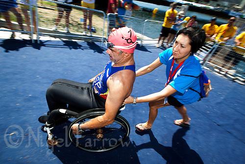 25 JUN 2011 - PONTEVEDRA, ESP - Rafael Lopez Ordonez (ESP is pushed to transition after finishing the swim at the European Paratriathlon Championships (PHOTO (C) NIGEL FARROW)