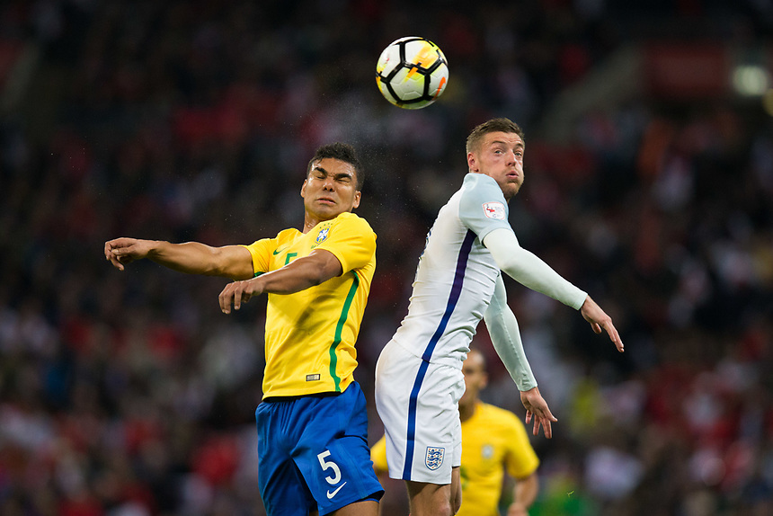 Brazil&rsquo;s Casemiro battles for possession with England's Jamie Vardy <br /> <br /> Photographer Craig Mercer/CameraSport<br /> <br /> The Bobby Moore Fund International - England v Brazil - Tuesday 14th November 2017 Wembley Stadium - London  <br /> <br /> World Copyright &copy; 2017 CameraSport. All rights reserved. 43 Linden Ave. Countesthorpe. Leicester. England. LE8 5PG - Tel: +44 (0) 116 277 4147 - admin@camerasport.com - www.camerasport.com