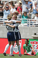 Cindy Parlow is congratulated by Abby Wambach after scoring a goal against Mexico in the second half in Albuquerque, NM, May 9. 2004. The USA won 3-0.