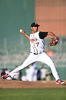 Lansing Lugnuts pitcher Alberto Tirado (7) delivers a pitch during a game against the South Bend Silver Hawks on June 6, 2014 at Cooley Law School Stadium in Lansing, Michigan.  South Bend defeated Lansing 13-5.  (Mike Janes/Four Seam Images)