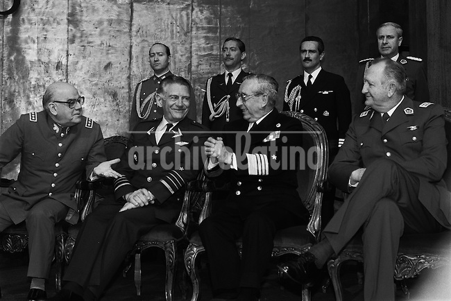Miembros de la junta militar en ceremonia  de proclamacivon de Pinochet  en el edificio Diego Portales como candidato unico en el plebiscito de 1988.<br /> Santiago Chile 30 Agosto 1988<br /> Forty years ago, on September 11, 1973, a military coup led by General Augusto Pinochet toppled the democratic socialist government of Chile. President Salvador Allende was killed during the  attack to seize  La Moneda presidential palace.  In the aftermath of the coup, a quarter of a million people were detained for their political beliefs, 3000 were killed or disappeared and many thousands were tortured.<br /> Some years later in 1981, while Pinochet ruled Chile with iron fist, a young photographer called Juan Carlos Caceres started to freelance in the streets of Santiago and the poblaciones or poor outskirts, showing the growing resistance against the dictatorship. For the next 10 years Caceres photographed every single protest and social movement fighting for the restoration of democracy. He knew that his camera was his only weapon, he knew that his fate was to register the daily violence and leave his images for the History.<br /> In this days Caceres is working to rescue and organize his collection of images in the project Imagenes de la Resistencia   . With support of some Chilean official institutions, thousands of negatives are digitalized and organized to set up the more complete visual heritage of this  violent period of Chile&acute;s history.<br /> In a time when technology was not very friendly and communications were kind of basic, Juan Carlos Caceres and other photojournalist were always at the right place in the right moment defying the threats of the police. Their work is now  a visual heritage that documents and remind us the fight of Chilean people for democracy.