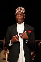 Zanzibar, Tanzania.  Taarab Musicians.  Culture Musical Club. Taarab Singer, wearing a traditional Zanzibari hat, a kofia.