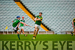 Colm Harty  Kerry releases the ball under pressure from Seamus Hickey Limerick during their Munster cup clash  in the Gaelic Grounds on Sunday