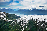 ALASKA, Juneau, ariel views of the beautiful Alaskan scenery seen from helicopter, the Helicopter Dogsled Tour flies you over the Taku Glacier to the HeliMush dog camp at Guardian Mountain above the Taku Glacier, Juneau Ice Field