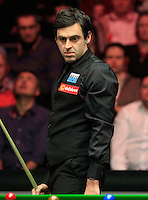 Ronnie O'Sullivan watches to see where the cue ball stops during the Dafabet Masters FINAL between Barry Hawkins and Ronnie O'Sullivan at Alexandra Palace, London, England on 17 January 2016. Photo by Liam Smith / PRiME Media Images