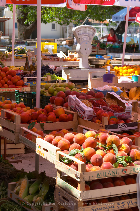 Peaches and other fruit. In the fruit and vegetable market in the harbour. Luka Gruz harbour. Dubrovnik, new city. Dalmatian Coast, Croatia, Europe.