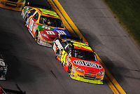 Feb 07, 2009; Daytona Beach, FL, USA; NASCAR Sprint Cup Series driver Jeff Gordon (24) leads Kyle Busch during the Bud Shootout at Daytona International Speedway. Mandatory Credit: Mark J. Rebilas-