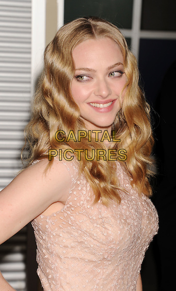 """Amanda Seyfried.""""Gone"""" Los Angeles Premiere held at Arclight Cinemas, Hollywood, California, USA..February 21st, 2012.half length beige white pink sleeveless print dress  side.CAP/ROT/TM.©Tony Michaels/Roth Stock/Capital Pictures"""