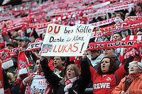 FUSSBALL   1. BUNDESLIGA  SAISON 2011/2012   34. Spieltag 1. FC Koeln - FC Bayern Muenchen        05.05.2012 FANS mit einem Plakat von Lukas Podolski (1. FC Koeln) verabschiedet sich bei den Fans
