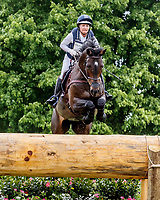LEXINGTON, KENTUCKY - APRIL 29: Under Suspection #49, with rider Hannah Sue Burnett (USA), clear an obstacle at Normandy Bank during the Cross Country Test at the Rolex Kentucky 3-Day Event at the Kentucky Horse Park on April 29, 2017 in Lexington, Kentucky. (Photo by Jesse Caris/Eclipse Sportswire/Getty Images)