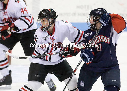 Casey Pickett (NU - 14), Kelly Horan (UConn - 21) - The University of Connecticut Huskies defeated the Northeastern University Huskies 4-1 in Hockey East quarterfinal play on Saturday, February 27, 2010, at Matthews Arena in Boston, Massachusetts.