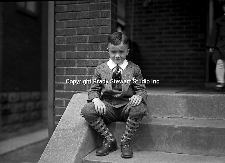 Wilkinsburg PA: Brady Stewart Jr dressed up for Sunday dinner at his grandparents - 1928.  Photo taken on the stoop at the Stewart house on 1007 East End Avenue in Wilkinsburg