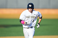 Evan Stephens (5) of the Wake Forest Demon Deacons hustles towards third base against the Duke Blue Devils at Wake Forest Baseball Park on April 25, 2014 in Winston-Salem, North Carolina.  The Blue Devils defeated the Demon Deacons 5-2.  (Brian Westerholt/Four Seam Images)