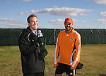 16 November 2007: Craig Waibel (r) is interviewed by Sean Wheelock (l). The Houston Dynamo practiced at the RFK Stadium Auxiliary Field in Washington, DC two days before playing in MLS Cup 2007, Major League Soccer's championship game.