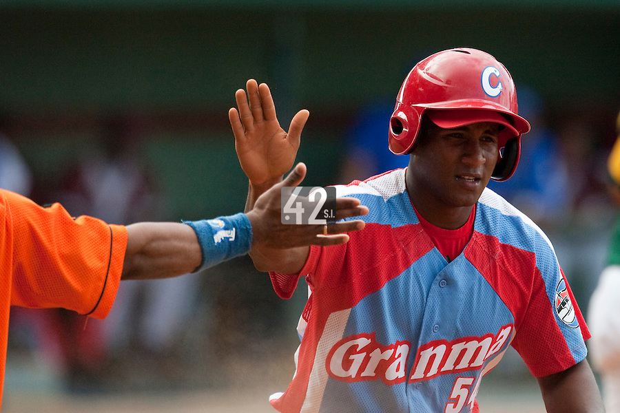 15 February 2009: Alfredo Despaigne of the Orientales is seen after scoring during a training game of Cuba Baseball Team for the World Baseball Classic 2009. The national team is pitted against itself, divided in two teams called the Occidentales and the Orientales. The Orientales win 12-8, at the Latinoamericano stadium, in la Habana, Cuba.