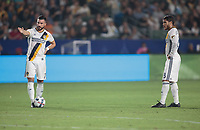 Carson, CA - Saturday August 12, 2017: Romain Alessandrini, Jonathan dos Santos during a Major League Soccer (MLS) game between the Los Angeles Galaxy and the New York City FC at StubHub Center.