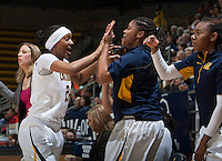Courtney Range of California gives double high fives to her teammates at the bench during the game against Oregon State at Haas Pavilion in Berkeley, California on January 3rd, 2014.  California defeated Oregon State, 72-63.
