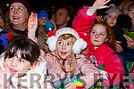 Amy O'Connell and Chloe O'Flaherty  welcome Santa at the Christmas in Killarney parade on Saturday evening