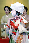A geisha performs a dance for customers at a geisha house in Tokyo, Japan.