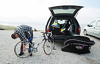 26 SEP 2013 - LANDS END, GBR - Dave Kershaw prepares his bike for the start of the Enduroman 2013 Lands End to London to Dover ultra triathlon at Lands End, Sennen, Cornwall, Great Britain (PHOTO COPYRIGHT © 2013 NIGEL FARROW, ALL RIGHTS RESERVED)