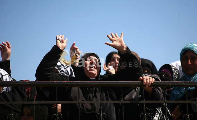 Palestinians women react during the funeral of Zakariya Abu Eram in the West Bank town of Yatta, near Hebron, Friday, March 9, 2012. According to the Israeli military, a Palestinian stabbed an Israeli soldier in the neck during a raid in the town of Yatta, seriously wounding him. The soldier opened fire, wounding the assailant and killing another man who was not involved in the attack, witnesses said. Photo by Mamoun Wazwaz