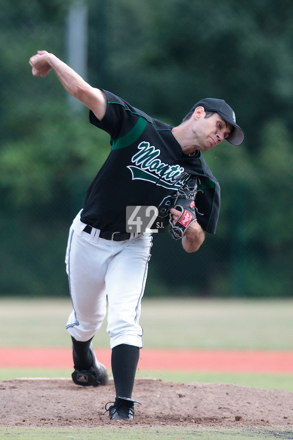 13 July 2010: Justin Fry pitches against Team France during day 1 of the Open de Rouen, an international tournament with Team France, Team Saint Martin, Team All Star Elite, at Stade Pierre Rolland, in Rouen, France.