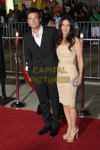 "JASON BATEMAN & AMANDA ANKA.""Couples Retreat""  Los Angeles Premiere held at  Manns Village Theatre, Westwood, California, USA..October 5th, 2009.full length married husband wife black grey gray suit beige cream yellow dress clutch bag silver platform shoes.CAP/ADM/TC.©T. Conrad/AdMedia/Capital Pictures."