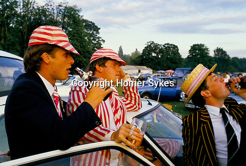 YOUNG MALES, WEARING STRIPED BLAZERS & SCHOOL CAPS, DRINKING BEER, HENLEY REGATTA HENLEY ON THAMES,