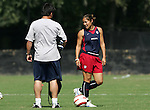 Lorrie Fair (r) and assistant coach Bret Hall (l) on Saturday, October 22nd, 2005 at Blackbaud Stadium in Charleston, South Carolina. The United States Women's National Team went through a light practice the day before a game against Mexico.