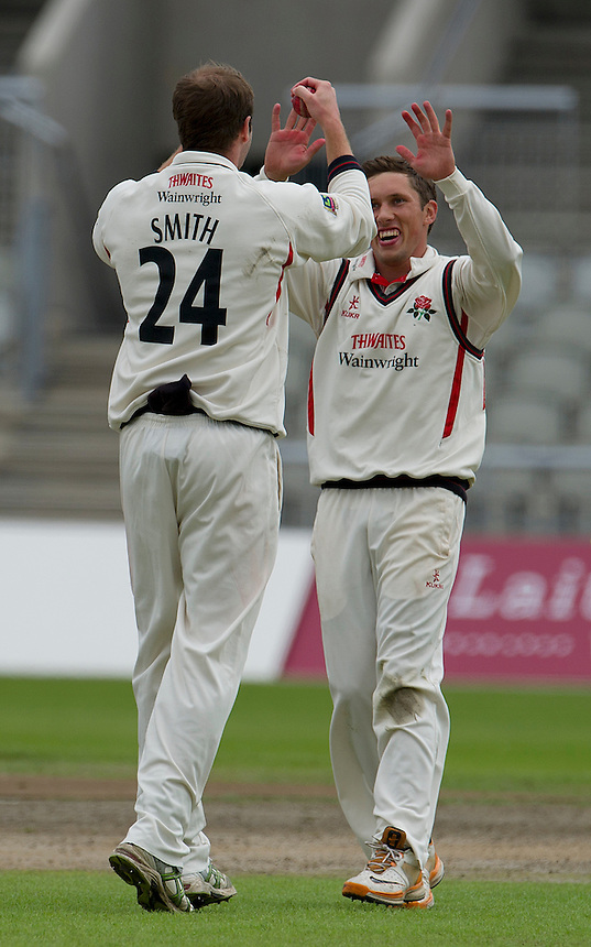 Lancashire's Simon Kerrigan (R) celebrates taking the wicket of Worcestershire's Captain Daryl Mitchell with team-mate and fielder who caught the ball Tom Smith - DKH Mitchell c Smith b Kerrigan 12 ..County Cricket - Liverpool Victoria County Championship - Division One - Lancashire v Worcestershire - Day 1 - Wednesday 18th July 2012 - Old Trafford - Manchester..