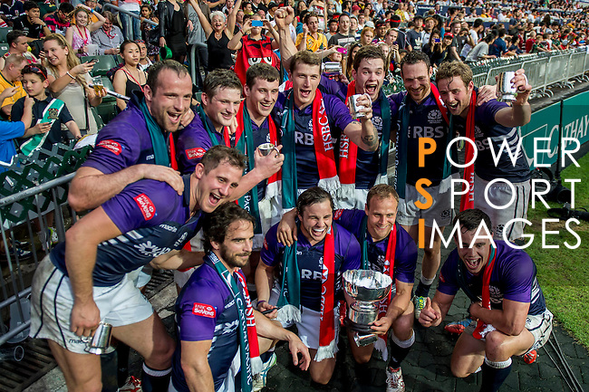 Scotland players celebrate with the trophy after winning the Bowl Final during the Cathay Pacific / HSBC Hong Kong Sevens at the Hong Kong Stadium on 30 March 2014 in Hong Kong, China. Photo by Juan Flor / Power Sport Images