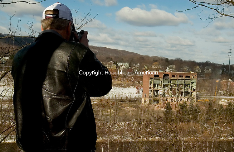 NAUGATUCK, CT-28 February 2008 --022808JS07--Bill Hass of Naugatuck takes a picture of the former Uniroyal Chemical Co. in Naugatuck after the two smokestacks were demolished on Thursday. <br /> Jim Shannon / Republican-American