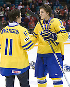 Marcus Johansson (Sweden - 11), Anton Lander (Sweden - 16) - Team Sweden celebrates after defeating Team Switzerland 11-4 to win the bronze medal in the 2010 World Juniors tournament on Tuesday, January 5, 2010, at the Credit Union Centre in Saskatoon, Saskatchewan.