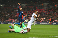 England's Callum Wilson is brought down by United States' Brad Guzan but no penalty was awarded<br /> <br /> Photographer Rob Newell/CameraSport<br /> <br /> The Wayne Rooney Foundation International - England v United States - Thursday 15th November 2018 - Wembley Stadium - London<br /> <br /> World Copyright © 2018 CameraSport. All rights reserved. 43 Linden Ave. Countesthorpe. Leicester. England. LE8 5PG - Tel: +44 (0) 116 277 4147 - admin@camerasport.com - www.camerasport.com