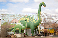 Giant dinosaur statues at the Rainbow Rock Shop along Route 66 in Holbrook Arizona.  The shop owner spent over 20 building the concrete dinosaurs.
