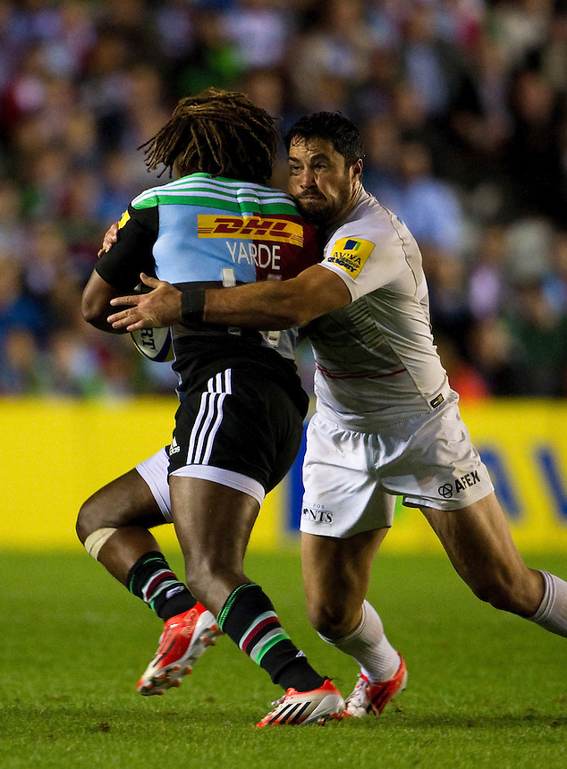 Harlequins' Marland Yarde is tackled by Saracens' Brad Barritt <br /> <br /> Photographer Ashley Western/CameraSport<br /> <br /> Rugby Union - Aviva Premiership - Harlequins v Saracens - Friday 12th September 2014 - Twickenham Stoop - London<br /> <br /> &copy; CameraSport - 43 Linden Ave. Countesthorpe. Leicester. England. LE8 5PG - Tel: +44 (0) 116 277 4147 - admin@camerasport.com - www.camerasport.com