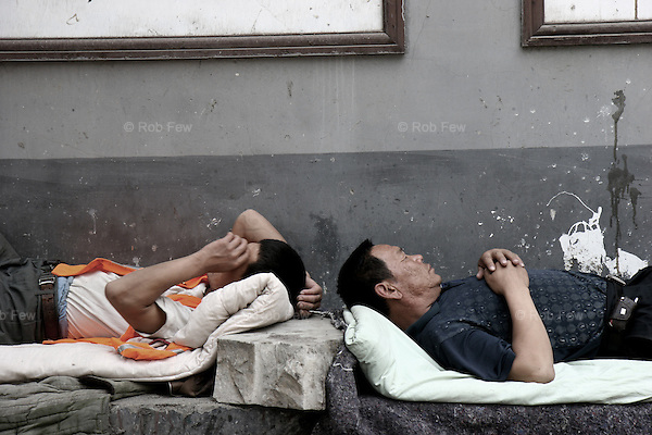 Workers take a break in a Beijing hutong.