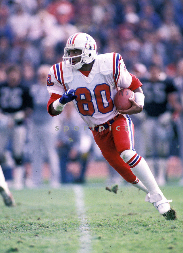 New England Patriots Irving Fryar(80) in action during a game against the Los Angeles Raiders at Los Angeles Memorial Coliseum in Los Angeles, California.  Irving Fryar played for 17 years with 4 different teams and was a 5-time Pro Bowler.David Durochik/SportPics