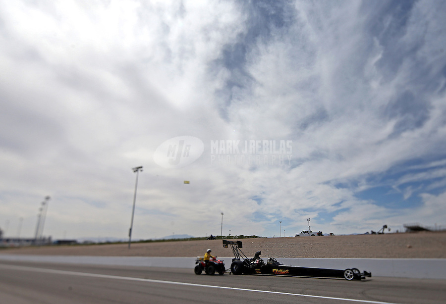 Apr. 6, 2013; Las Vegas, NV, USA: NHRA top fuel dragster driver Troy Buff during qualifying for the Summitracing.com Nationals at the Strip at Las Vegas Motor Speedway. Mandatory Credit: Mark J. Rebilas-