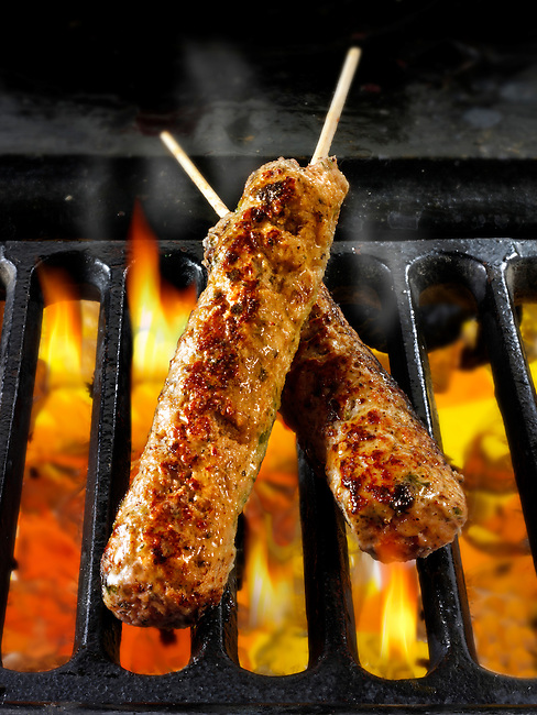 Lamb & mint kebabs being cooked over hot charcoal. Food photos, pictures & images.