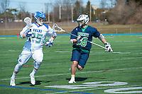 Sharp Jones,'16, left, races to the goal as the Seahawks battle Endicott in Men's Lacrosse at Gaudet Field in Middletown.