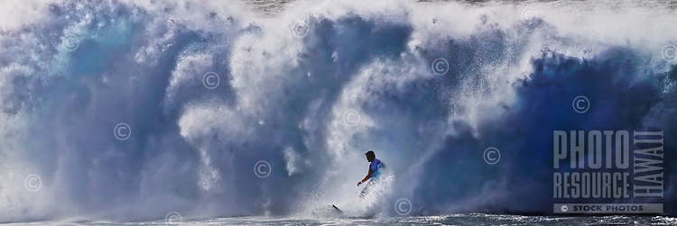 A surfer at Banzai Pipeline off of 'Ehukai Beach, North Shore of O'ahu.