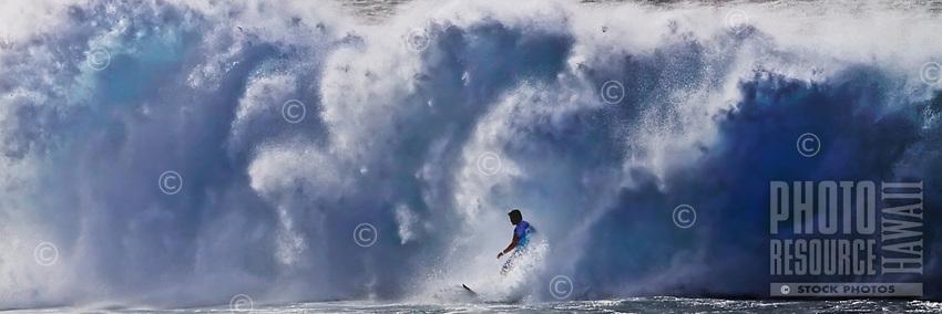A surfer atBanzai Pipeline off of 'Ehukai Beach,North Shore of O'ahu.