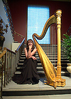 April,  2001, Montreal, Quebec, Canada<br /> <br /> A harp player sit beside her instrument before playing during a reception at the Montreal Museum of Fine Arts.<br /> Only verbal agreement for editorial use.<br /> No signed model and/or property release<br /> <br /> Mandatory Credit: Photo by Pierre Roussel- Images Distribution. (©) Copyright 2001 by Pierre Roussel <br /> ON SPEC<br /> NOTE l Nikon D-1 jpeg opened with Qimage icc profile, saved in Adobe 1998 RGB.