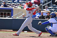 Xavier Scruggs #16 of the Memphis Redbirds swings against the Omaha Storm Chasers at a piitch at Werner Park on April 9, 2014 in Omaha, Nebraska. The Storm Chasers beat the Redbirds 20-3.   (Dennis Hubbard/Four Seam Images)